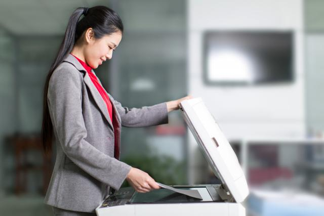 lady standing by copier machine